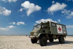 Ambulance. Military ambulance on sunny beach with blue sky Stock Photo