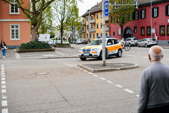 Ambulance arriving fast at accident place in German city Stock Photo