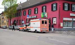 Ambulance arriving fast at accident place in German city Royalty Free Stock Images
