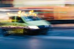 Ambulance in a Blurred City Scene Stock Image