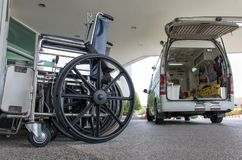 The ambulance car arrived to the entrance of hospital. The wheelchairs are in a row at the entrance to the hospital stock photo