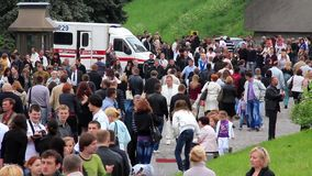 Ambulance car and crowd of people stock video footage