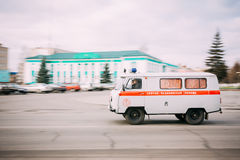 Ambulance car going fast down the street. Dobrush, Belarus -November 29, 2011: Ambulance car going fast down the street Royalty Free Stock Photography