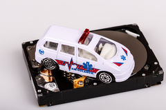 Ambulance car on harddrive or hdd - data rescue concept Stock Images