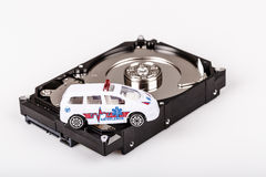 Ambulance car on harddrive or hdd - data rescue concept. Ambulance car on harddrive or hdd - data backup, safe and rescue concept stock photography