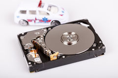Ambulance car on harddrive or hdd - data rescue concept. Ambulance car on harddrive or hdd - data backup, safe and rescue concept royalty free stock photo
