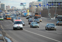The ambulance car moving on the allocated strip. Volokolamskoye Highway. Moscow Stock Photos