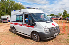 Ambulance car parked up in the rural street. Text on russian: Royalty Free Stock Photography