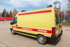 Ambulance car parked up in the street. Text on russian: Royalty Free Stock Photos