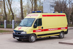 Ambulance car parked up in the street. Text on russian: Royalty Free Stock Images