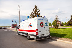 Ambulance car parked up in the street. Text in russian: Royalty Free Stock Photo