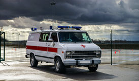 Ambulance car on race track. Stormy weather Royalty Free Stock Photography