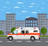 Ambulance car on road in urban landscape Royalty Free Stock Photos