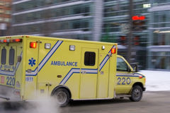 Ambulance car speeding city blurred motion. Ambulance car speeding blurred motion in americam city on street warning lights flashing dramatic smoke Royalty Free Stock Photography