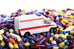 Ambulance car toy ride through pills. (installation on the theme of modern methods of medicine stock photos