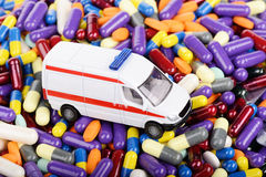 Ambulance car toy ride through tablets. (installation on the theme of modern medicine trends Stock Photography