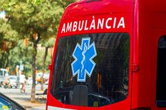 Ambulance care assistants drive on street. Emergency help. stock photo