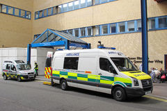 Ambulance cars in entrance of hospital Royalty Free Stock Image