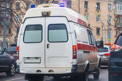Ambulance on the city street. In a traffic jam Stock Image