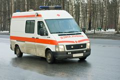 Ambulance drives down the street Royalty Free Stock Image