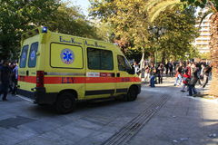 Ambulance enters square to carry injured people Royalty Free Stock Photos