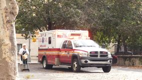 FDNY Ambulance. An ambulance of the Fire Department of New York, parked at the Sara Delano Roosevelt Park, in downtown Manhattan stock footage