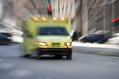 Ambulance going down the street Royalty Free Stock Images