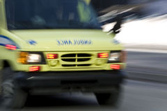 Ambulance going fast down street Royalty Free Stock Photography