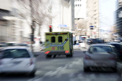 Ambulance going trough traffic Royalty Free Stock Photography