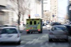 Ambulance going trough traffic royalty free stock photography