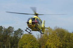 Ambulance Helicopter - Dutch Lifeliner 1 (Medevac) - approaching for landing. Almere, Flevoland, The Netherlands - October 30, 2015: Dutch Ambulance Helicopter ( royalty free stock photography