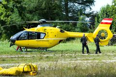 An ambulance helicopter landed in a mountainous village in the field.  royalty free stock photos