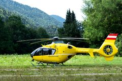 An ambulance helicopter landed in a mountainous village in the field.  stock photos