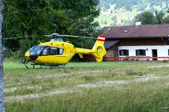 An ambulance helicopter landed in a mountainous village in the field.  stock photo
