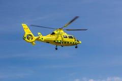 Ambulance helicopter in mid air. Klövsjö, Jämtland, Sweden - July 25, 2016: Ambulance helicopter in mid air. Ambulance helicopter in mid air after stock image
