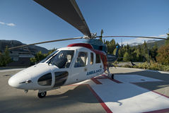 Ambulance Helicopter in mountains Stock Image