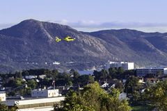 Ambulance Helicopter in Stavanger. STAVANGER, NORWAY - SEPTEMBER 23, 2017: A yellow ambulance helicopter lands at Stavanger Hospital Stock Photos
