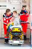 Ambulance helping injured woman Royalty Free Stock Photography
