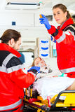 Ambulance helping injured woman with infusion Stock Photography