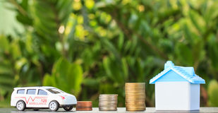 Ambulance and house on coin on background. Royalty Free Stock Photo