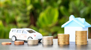 Ambulance and house on coin on background. Royalty Free Stock Image