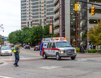 Ambulance in an intersection in Grand Rapids, Michigan royalty free stock photography