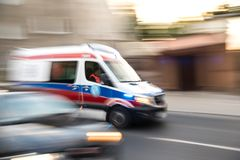 Ambulance in motion driving down the road stock photos