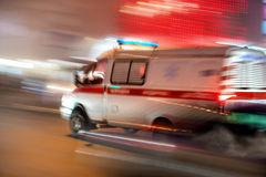 Ambulance in motion. Driving down the road at night. Intentional motion blur stock photos