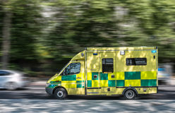 Ambulance. In motion on the road stock photography