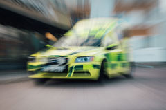 Ambulance in motion. Yellow ambulance with moving motion effect stock images