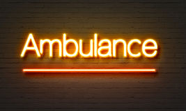 Ambulance neon sign on brick wall background. Royalty Free Stock Images