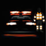 Ambulance at night and staff in a light vest Royalty Free Stock Images