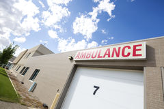 Ambulance Parking Garage Against Sky. Low angle view of ambulance parking garage against sky on sunny day Stock Image