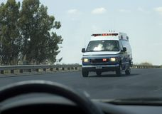 Ambulance Passing By Stock Photos
